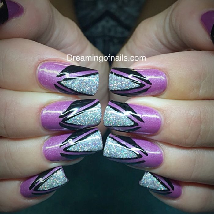 Light purple nails with black and silver glitter design