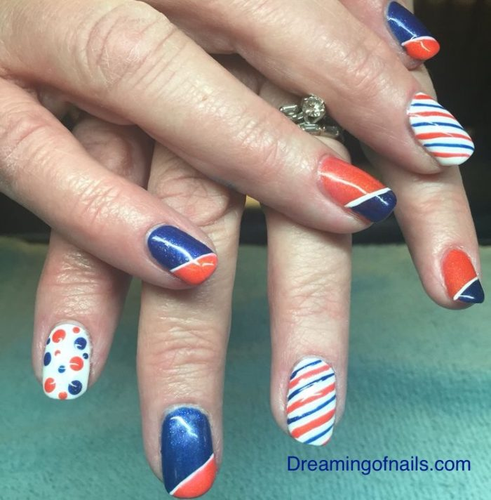 Broncos nail art with polka dots and stripes - Denver Broncos Nails - Dreaming Of Nails