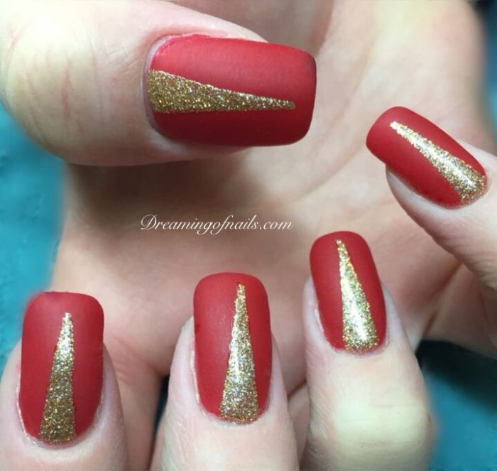 Red matte nails with gold glitter design