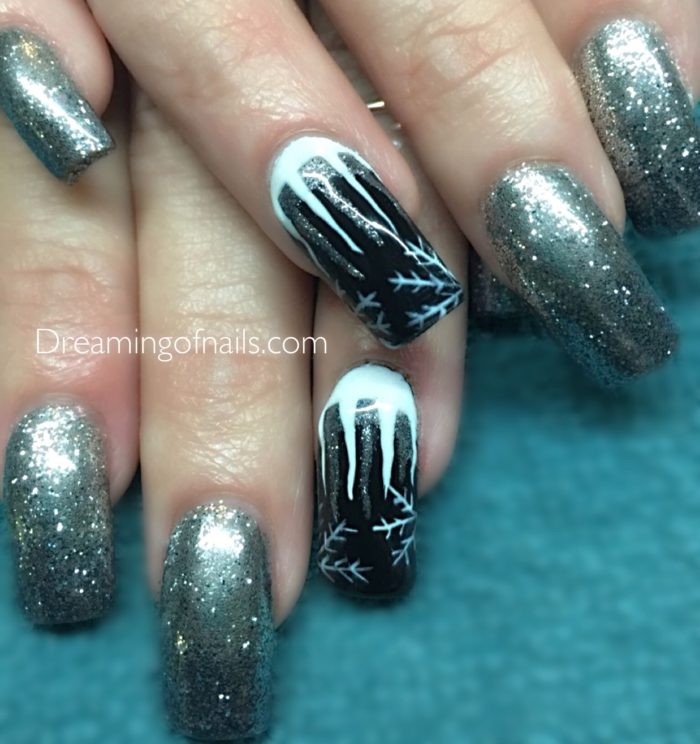 Silver glitter nails with black and white icicles
