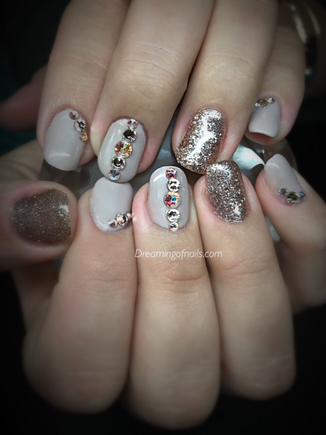 Beige nails with rhinestones and rose gold glitter