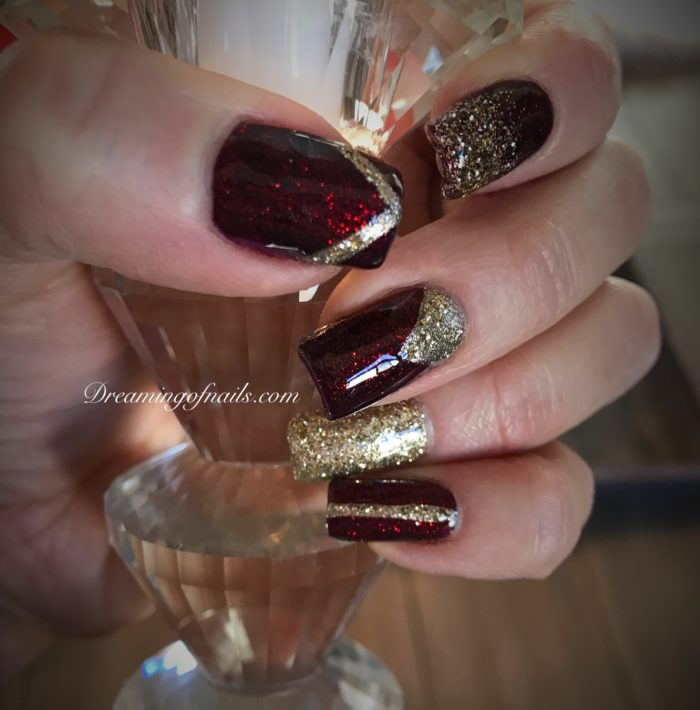 Deep burgundy and gold glitter nails with gold nail art
