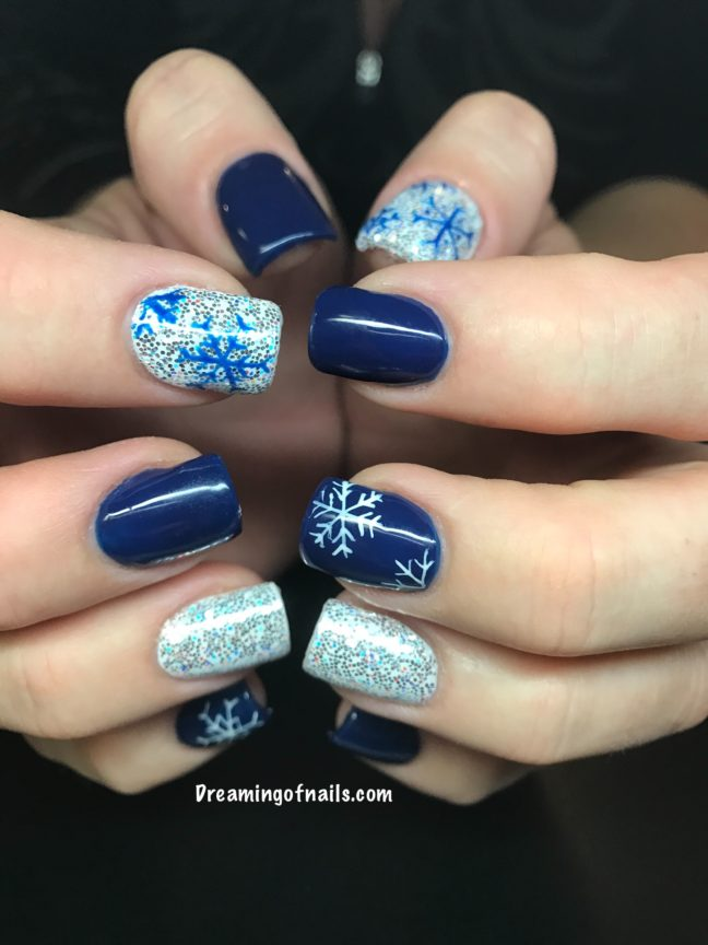 navy blue nails with snowflakes and glitter accent nails - Blue Christmas Nails