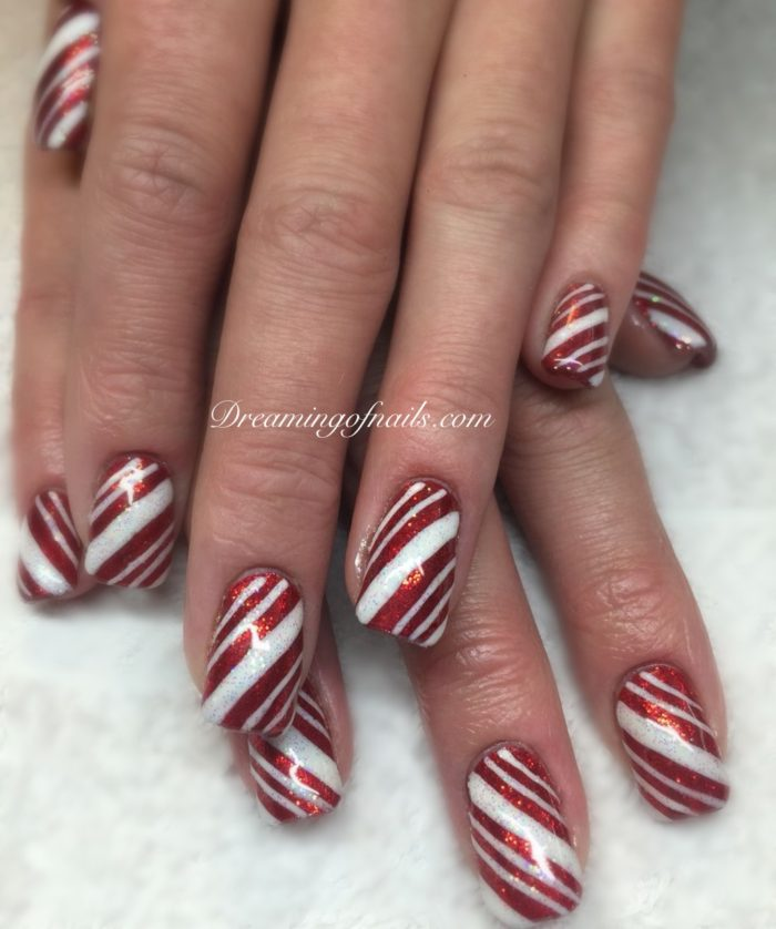 Red and white glitter nails with candycane stripes