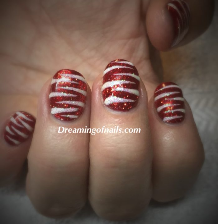 Red glitter nails with white glitter stripes