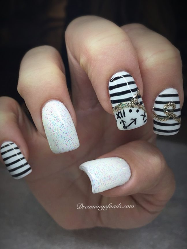 Black and white striped New Years nails