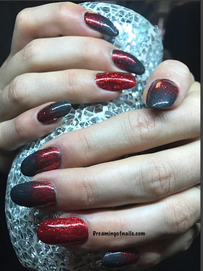 Gray nails with red glitter accents