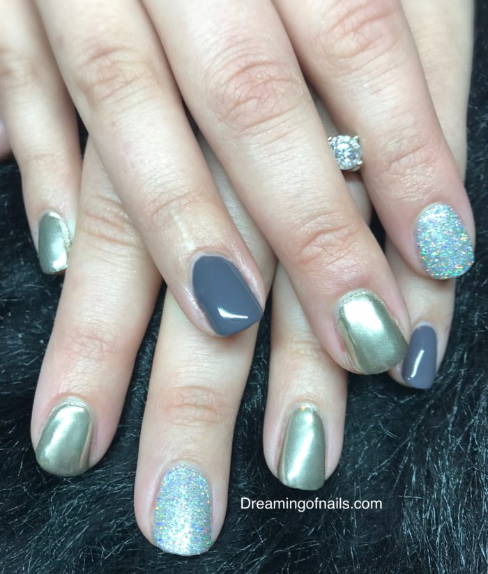 Gray nails with silver chrome and glitter accent nails
