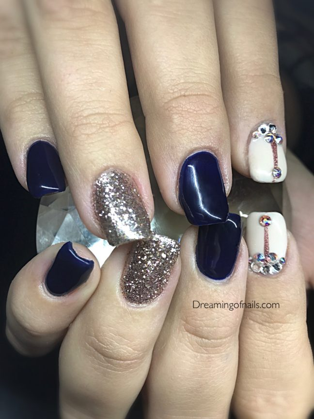 Navy nails with glitter accents and Swarovski crystals