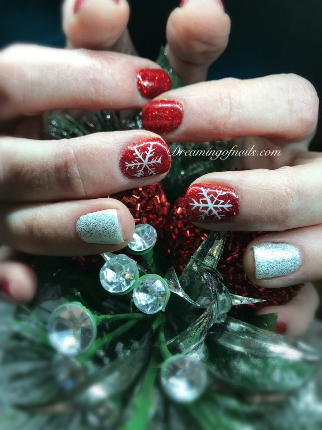 Red and white glitter nails with painted snowflakes
