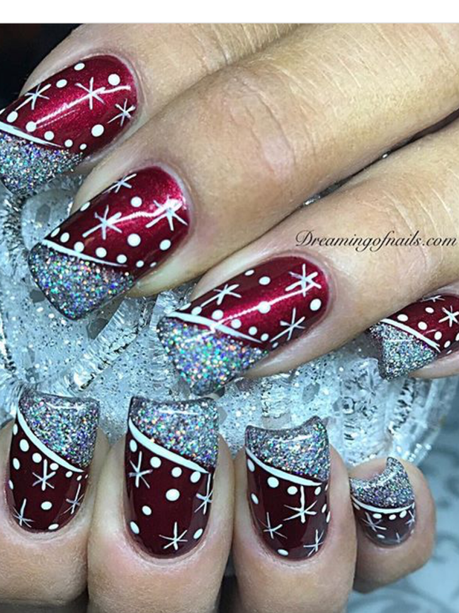 Red Christmas nails with silver glitter and painted art