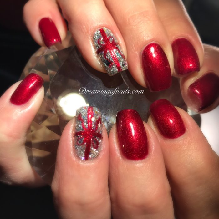 Red nails with glitter present accents nails