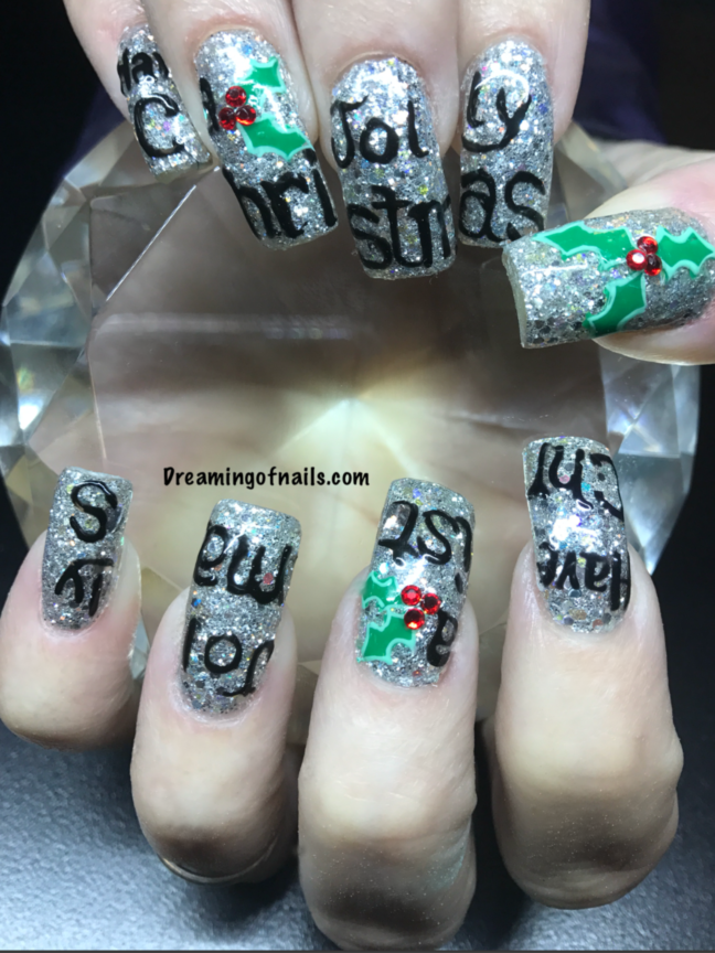 Silver glitter Christmas nails with painted have a holly jolly Christmas