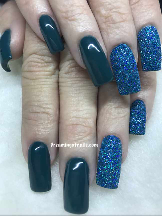 Teal nails with turquoise glitter accent nails