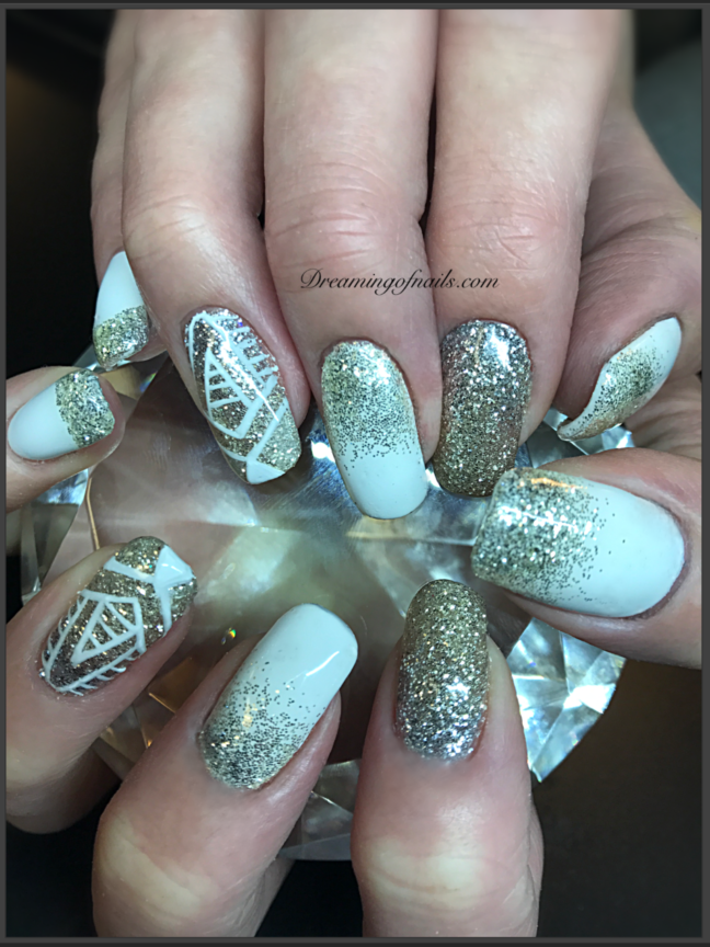 White and gold glitter nails with white hand painted design