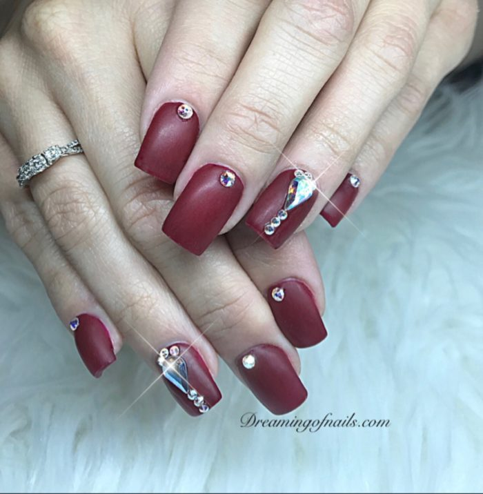 Dark red matte nails with Swarovski crystals
