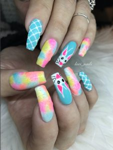Colorful Spring Easter nails with bunny and water drops