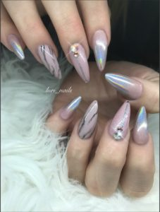 Pink and holo stiletto nails with marble design and Swarovski crystals