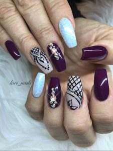 Plum and glitternails with hand painted design and Swarovski crystals