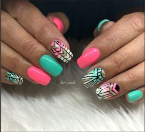 Turquoise and hot pink nails with hand painted Aztec design