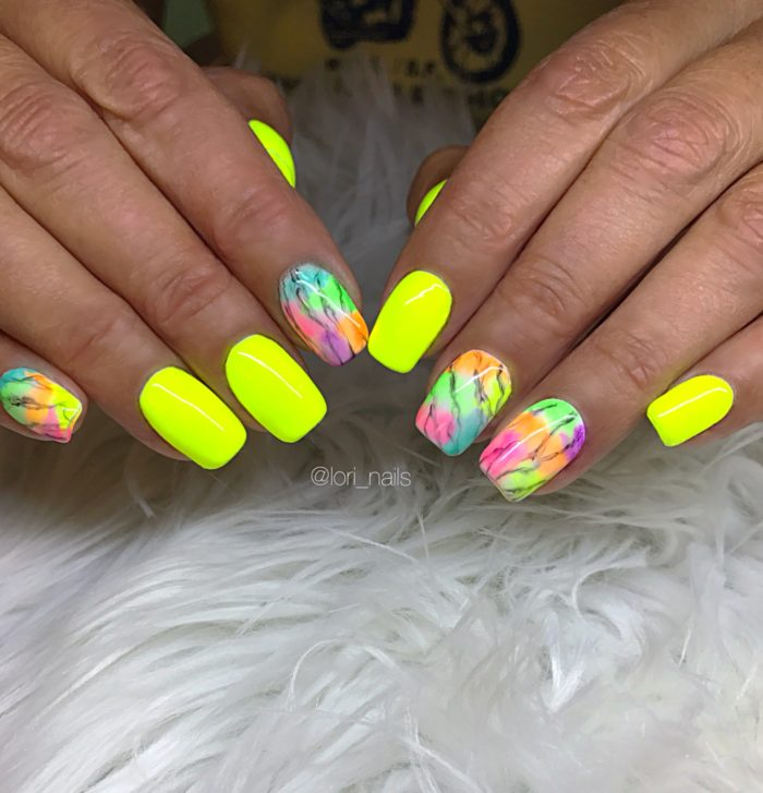 Neon yellow watercolor nails with marble design