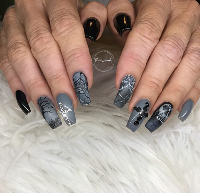 Gray and black Halloween nails with spiderwebs and swarovski crystals
