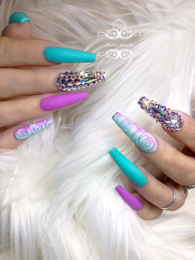 Purple and turquoise nails with blooming roses and swarovski crystals