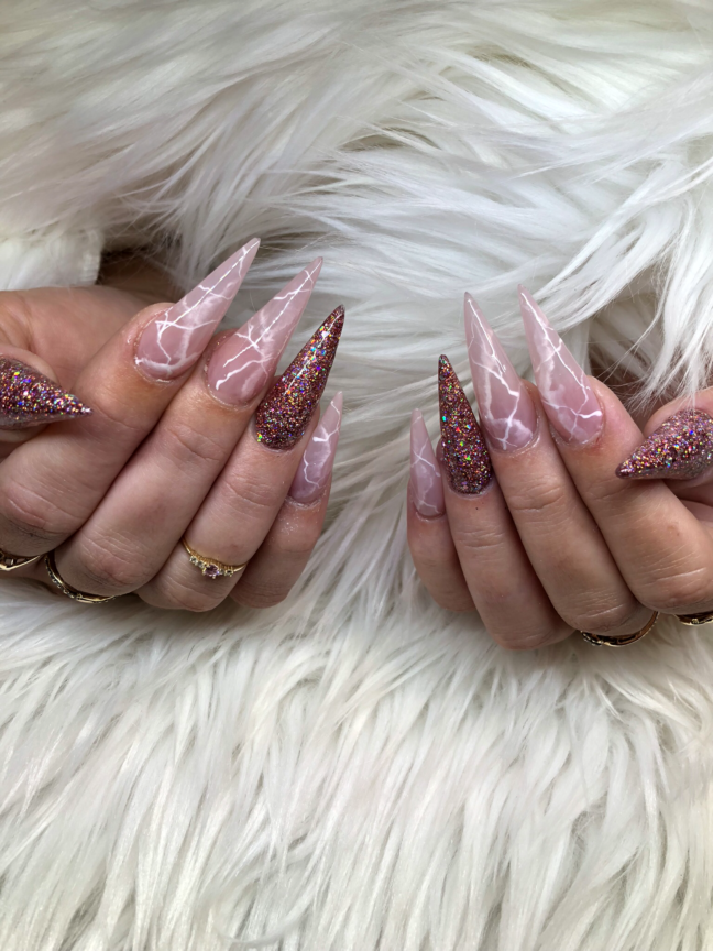 Stiletto nails with rose quartz design
