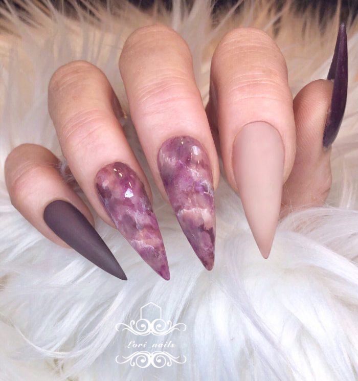 Beige and purple stiletto marble nails