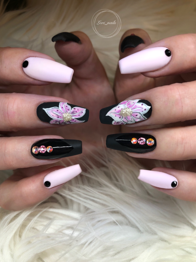 Black and pink nails with hand painted flowers