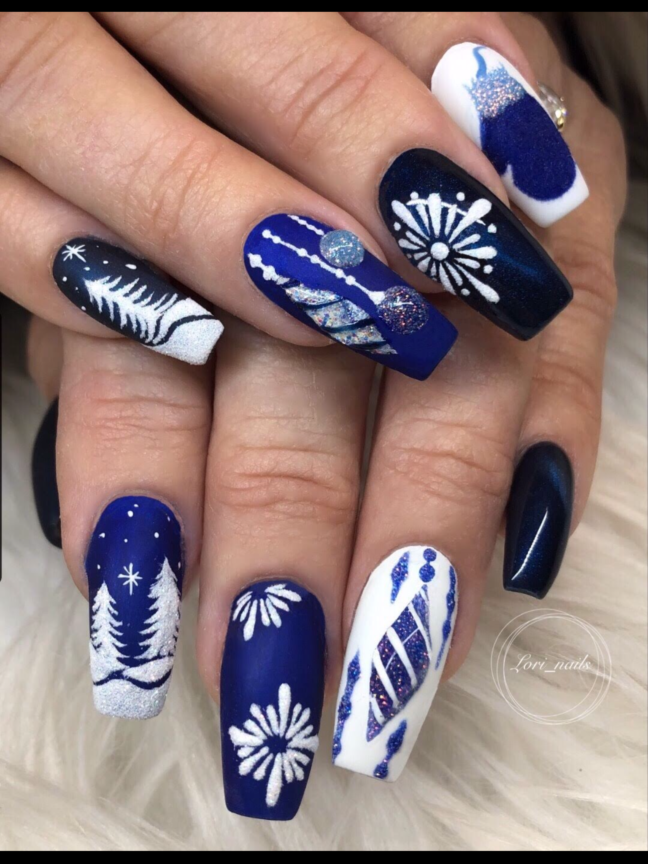 Blue and white Christmas nails with ornaments mittens and trees