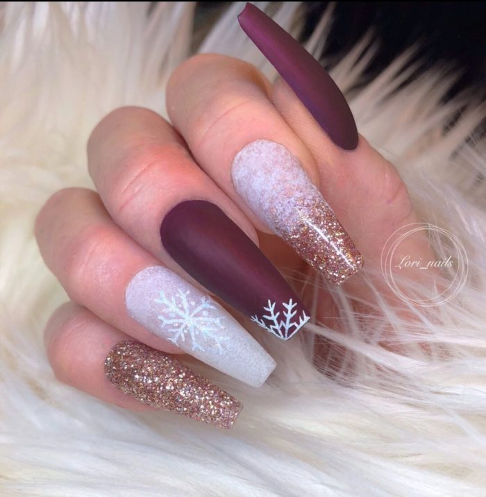 Burgundy and white snowflake nails with rose gold glitter