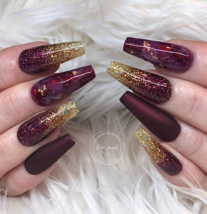 Burgundy red and gold marble nails
