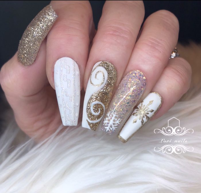 Gold and white sweater nails with glitter snowflakes and swirls