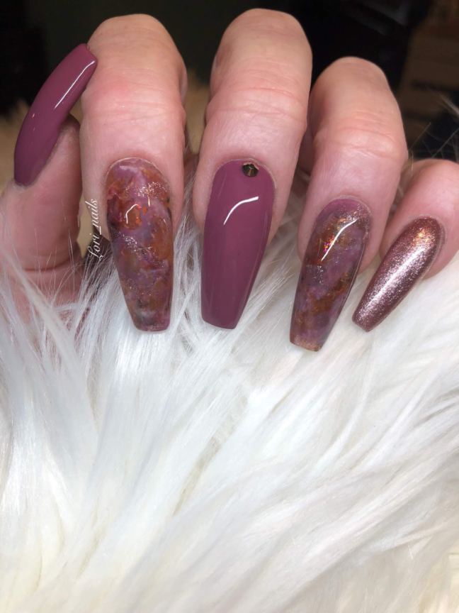 Maybe and brown marble nails with rose gold