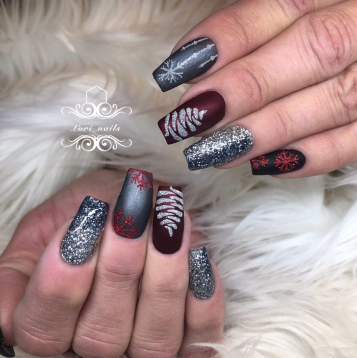 Red and gray Christmas nails with glitter trees and snowflakes