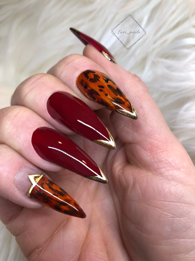 Red leopard nails with gold tips