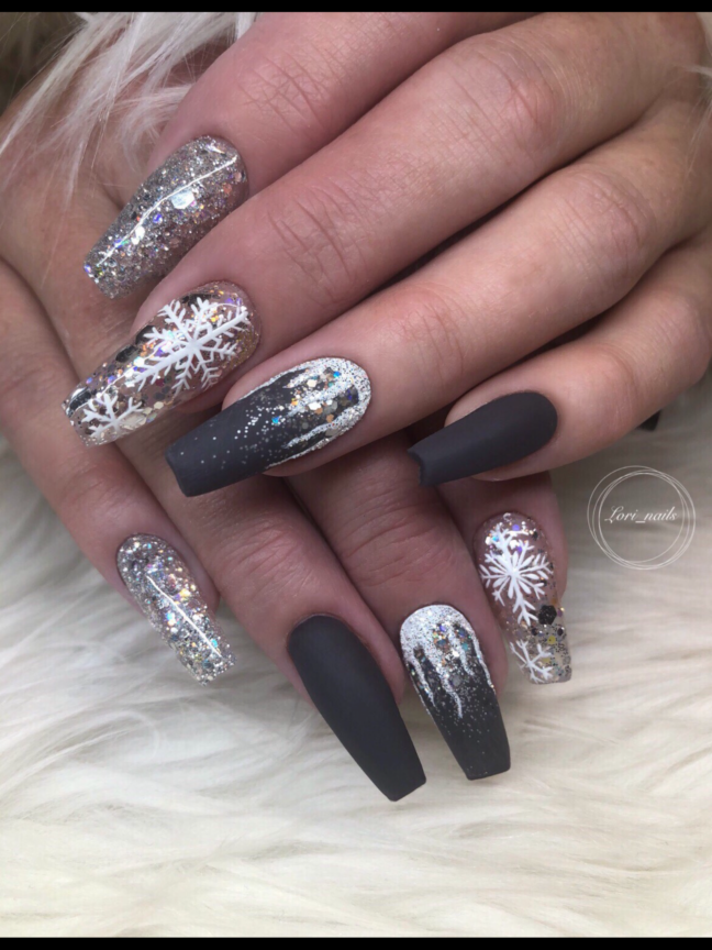 Silver gray and white winter snowflake nails