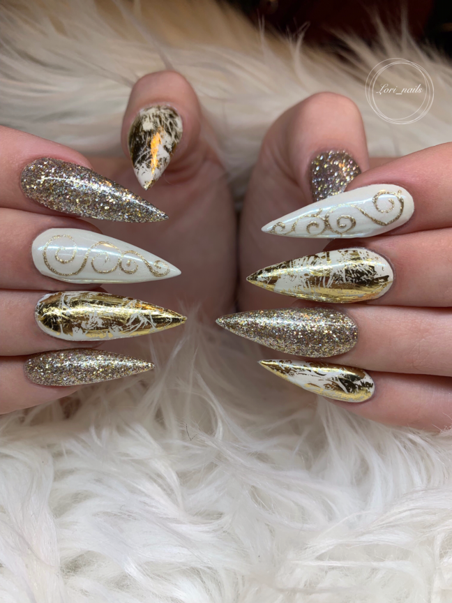 White and gold glitter winter nails with swirls