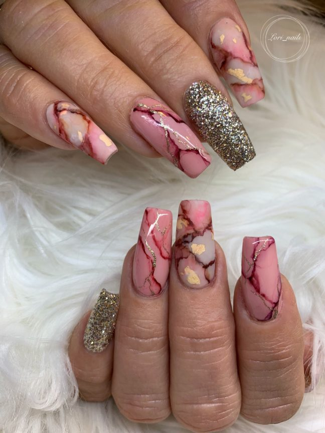 Beige and light coral marble design nails