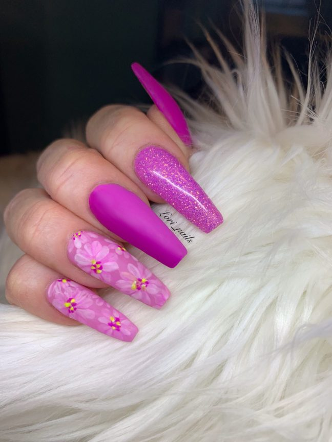 Fuchsia pink flower nails with glitter