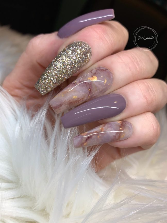Nude and light plum marble nails with gold glitter accent