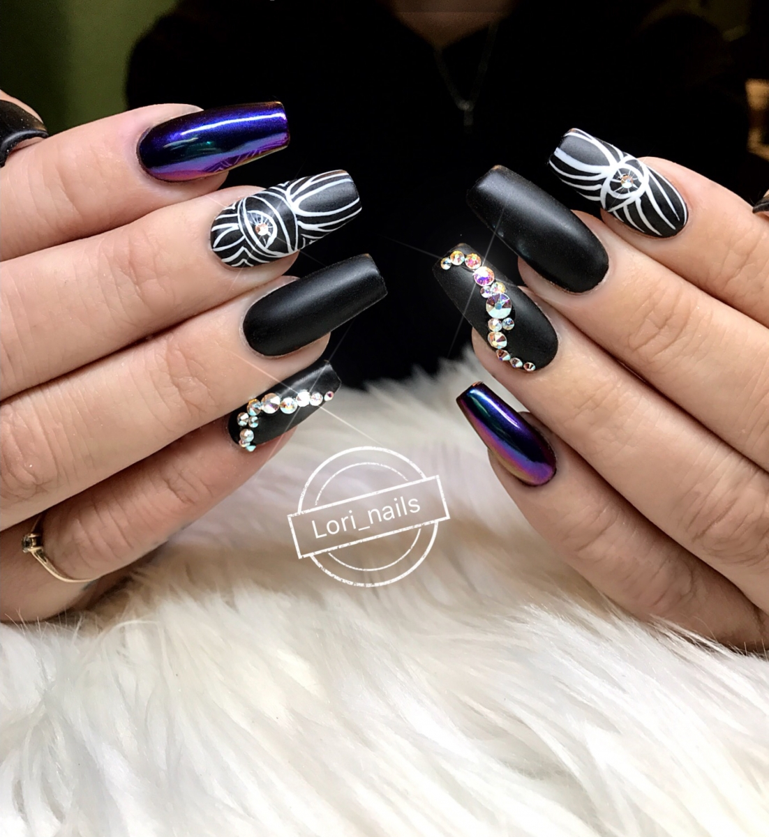 black-matte-nails-with-art-swarovski-crystals-and-purple-chrome