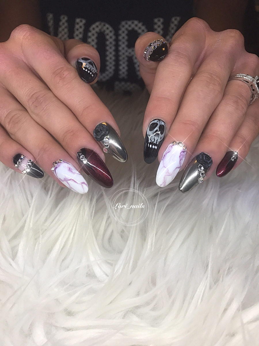 halloween-nails-with-chrome-marble-skulls-and-swarovski-crystals